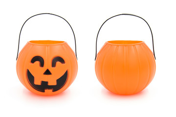 Halloween cute plastic toy pumpkin head basket closeup isolated on white background