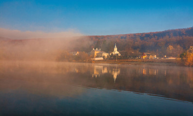 Autocollant pour porte Chateau Fog over the water of Bled Lake in front of the church with reflection in the lake on a beautiful autumn morning