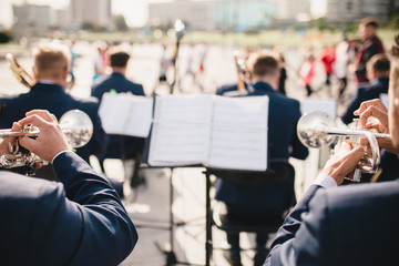 Close-up performance of a brass band on behalf of musicians