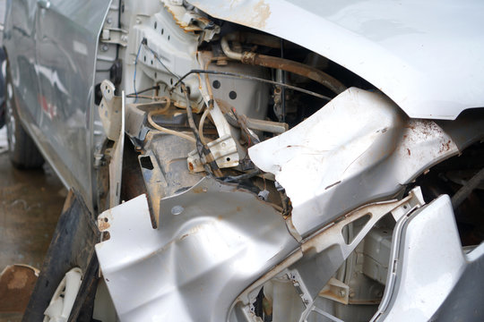 car accident get collision damaged on garage and repair with insurance