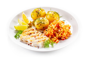 Fish dish - fried fish fillet boiled potatoes and vegetables