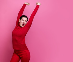 girl in red sweater posing on pink studio background. positive emotions. artistic girl. free space for copy paste