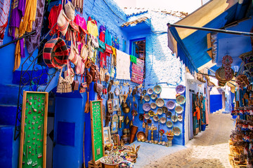 Deurstickers Marokko Traditional carpets on the blue Chefchaouen street.