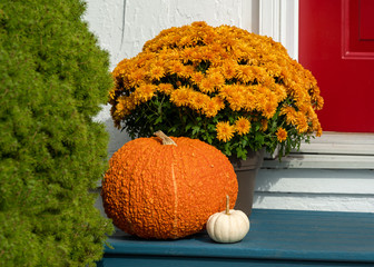 Fall arrangement on the front door step of a home.