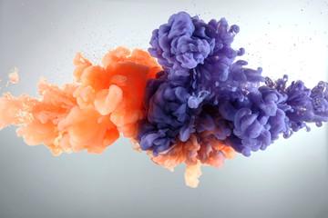 Orange and purple paint splash isolated on white background