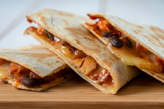 Chicken And Black Beans Quesadillas With Cheese And Salsa