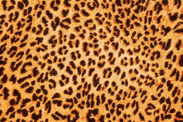 Papiers peints Leopard Black spots of different shapes on orange background - background as leopard skin