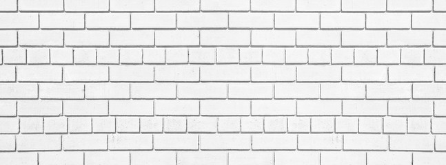 White brick long texture. Lime washed brickwork wide background. Light painted block wall abstract backdrop