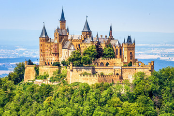 Fotorollo Himmelblau Hohenzollern Castle close-up, Germany. This fairytale castle is famous landmark near Stuttgart. Scenic view of mount Burg Hohenzollern in forest. Scenery of Swabian Alps with Gothic castle in summer.