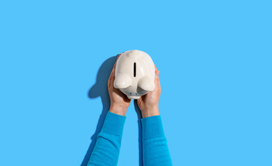 Person holding a piggy bank from above