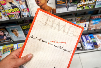 Time magazine in a hand