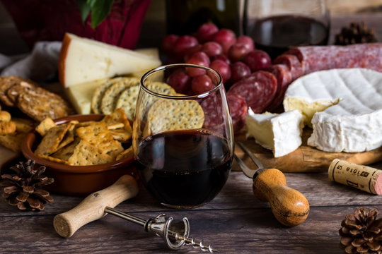 Stemless wine glass and cheese spread.