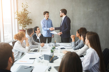 Wall Mural - CEO congratulating successful worker by shaking hands