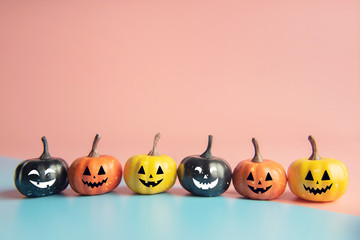 Halloween concept, Pumpkin with smile face on pastel colors background.