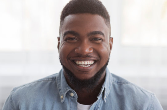 Portrait of black millennial guy with happy smile on face