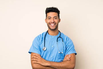 Young handsome man over isolated background with doctor gown