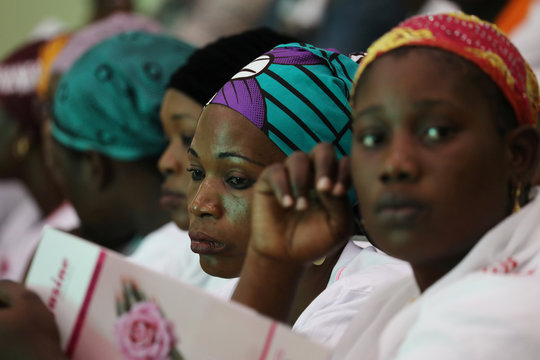 Women attend a meeting during the breast cancer prevention campaign in Abidjan, Ivory Coast