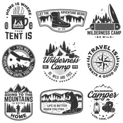 Set of outdoor adventure quotes symbol. Concept for shirt or logo, print, stamp or tee. Vintage design with hiking boots, fishing bear, mountains, compass, knife, tent and forest silhouette