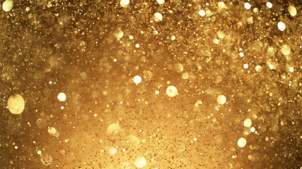 Abstract golden glittering background with blur dots.