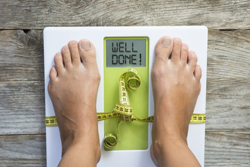 Diet motivation message on weight scale suggesting losing kilogram success