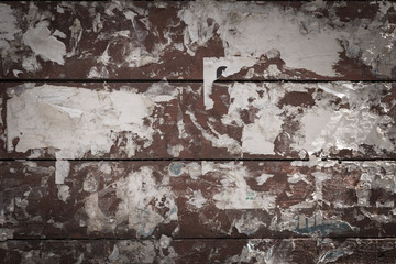 Rustic painted brown wooden background with glue and paper close up