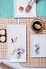 top view of Different rolls background. Traditional sushi. Delicious japanese food.various sushi on white plate