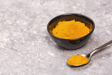 Turmeric powder close up on a grunge cooking table