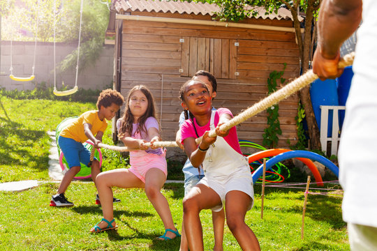 Rope pulling action game kids in diverse group