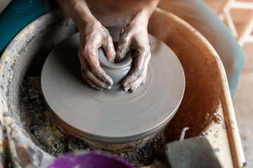 Woman making ceramic work with potter's wheel Fototapete