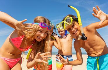 Kids waving hands wearing scuba snorkeling masks