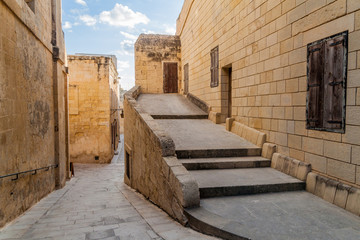 Spoed Foto op Canvas Smal steegje Narrow streets in the fortified city Mdina in the Northern Region of Malta