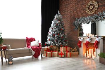 Stylish room interior with beautiful Christmas tree