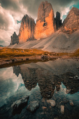 Tuinposter Bergen Three Peaks in the Dolomites reflecting in a lake, Italy