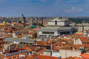 Aerial view of the Madrid cityscape with Almudena Cathedral and Teatro Real rooftops in the city center in Madrid, Spain