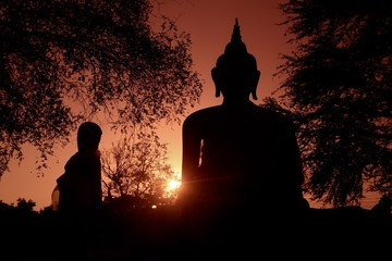 Beautiful silhouette shot of a Buddha statue in Thailand during sunset. Great for a wallpaper
