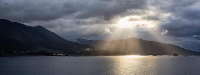 Wall Mural - Beautiful Panoramic View of Sunrays over the Ocean Coast during a stormy morning. Taken near Ketchikan, Alaska, United States.