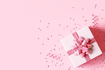 Gift box with confetti on pastel pink background. 3d rendering