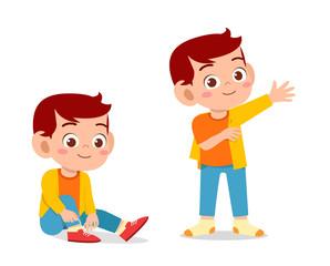 happy cute kid boy do dressing process