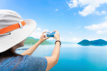 Traveler snap photo by smartphone.  Travel concept
