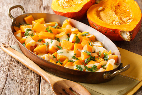 Healthy pumpkin casserole with mozzarella cheese and herbs close-up in a baking dishe. horizontal