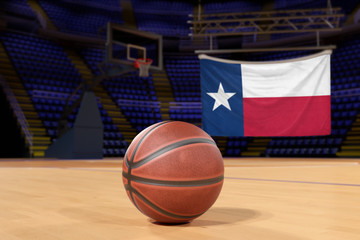 Texas state flag and basketball on Court Floor