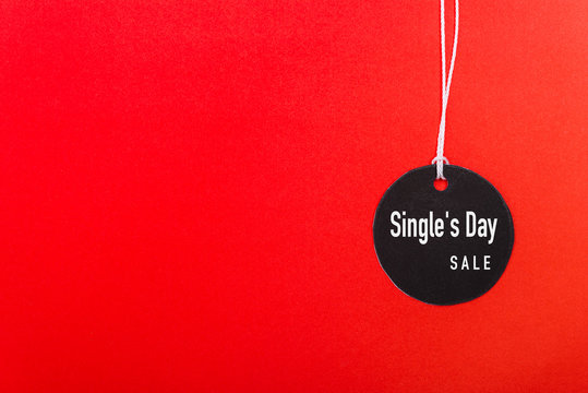Online shopping Single's day sale text on Circle Black tag label on red background