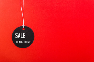Online shopping Black Friday sale text on Circle Black tag label on red background