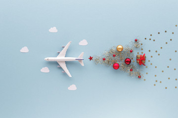 Aluminium Prints Airplane Christmas composition. Airplane flying in sky star gift bauble top view background with copy space for your text. Flat lay