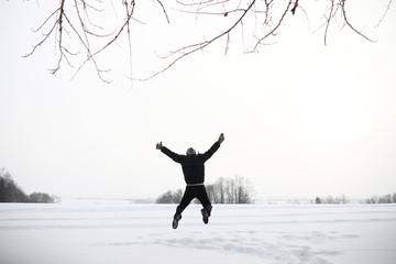 A man on a walk. Winter landscape. Tourist in winter journey.