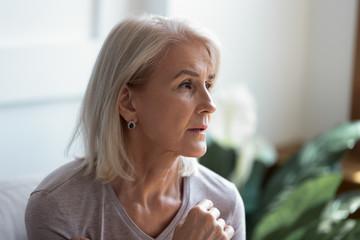 Close up image serious pensive sad aged female