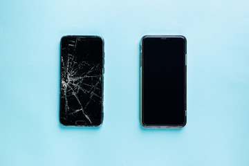 Obraz Modern touch screen smartphone with broken screen and new one on blue background, top view - fototapety do salonu