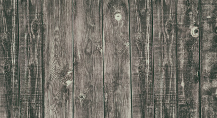 Old rough uneven wooden board widescreen retro style texture. Knotty weathered natural solid wood faded rustic background