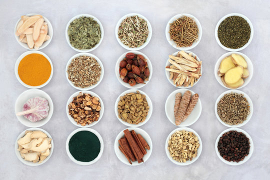 Asthma and respiratory relieving herbs, spice and supplement powders used in natural and chinese herbal medicine in porcelain bowls. Flat lay.