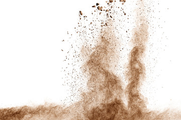 Brown dust explosion cloud.Brown particles splatter on white background.